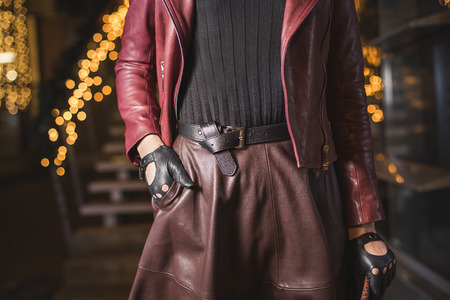 leather gloves: Woman with leather belt and gloves fashion look Stock Photo