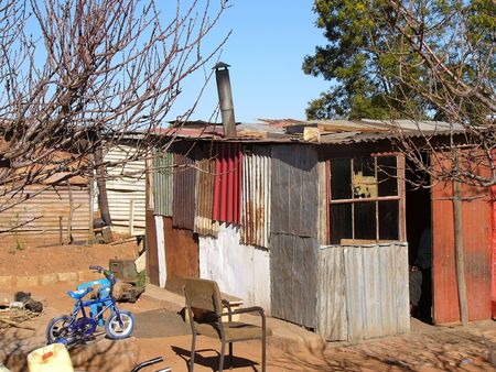were: A corrugated iron dwelling in Soweto, South Africa. The inhabitants were unemployed and unable to find work.