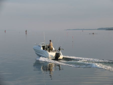 evening out: Boat going out fishing a beautiful summer evening. Stock Photo