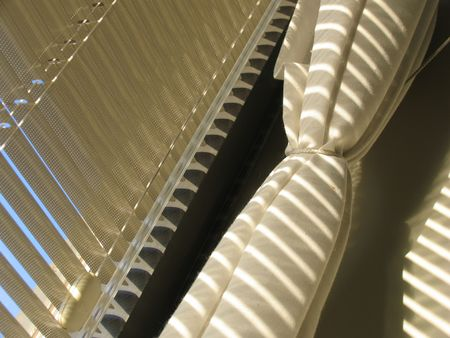 Detail of window with blinds and curtains. Stock Photo