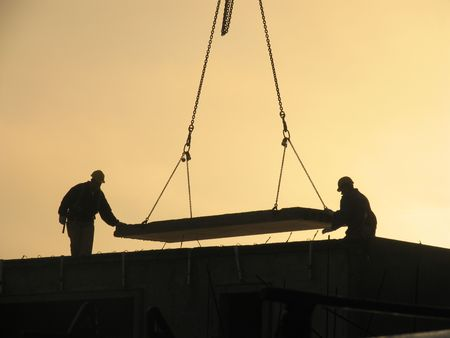Constructing apartments at overtime. Stock Photo