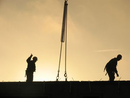 constructing: Constructing apartments at overtime. Stock Photo
