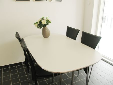 Dining table in modern Danish kitchen Stock Photo