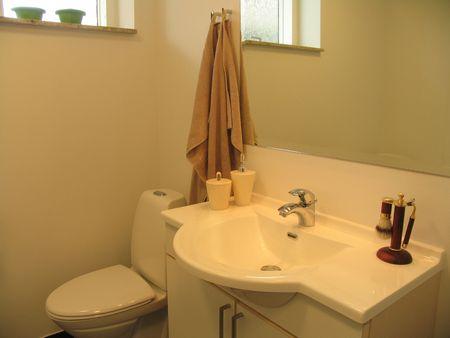 powder room: Extra toilet in modern apartment. Stock Photo