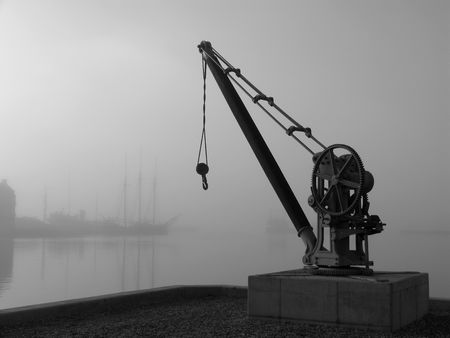 Retro crane a foggy day in the harbour. photo