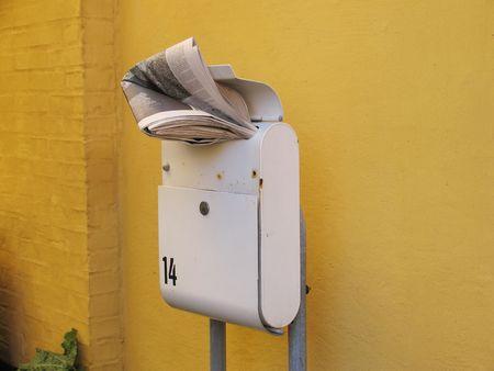 Newspaper in Danish letterbox. photo