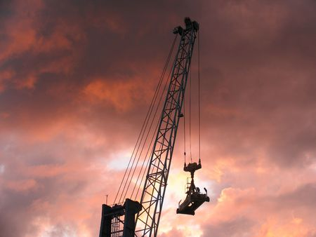Container crane at sunset photo