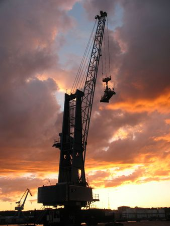 Container crane at sunset