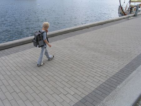 seven years: Seven years old boy on his way from school.
