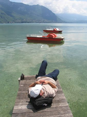 siesta: Siesta at  Lake Annecy, France. Stock Photo