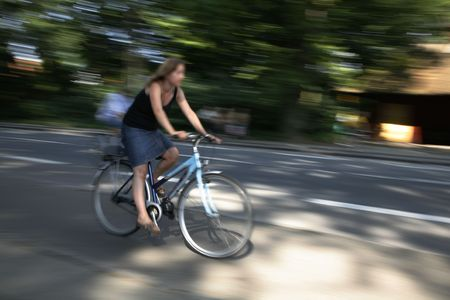 Young Danish female in full speed on his bike. Stock Photo - 955560
