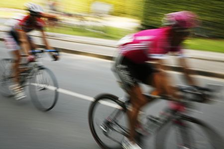 The cyclists riding by at the bicycle race Around Denmark 2006. Stock Photo - 955562