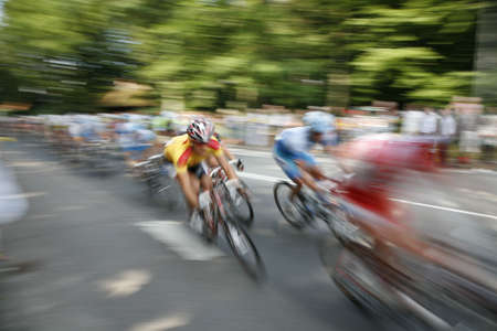 The cyclists riding by at the bicycle race Around Denmark 2006.
