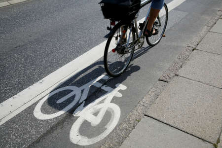 Cyclist passing by on urban cycle path. Stock Photo - 955573