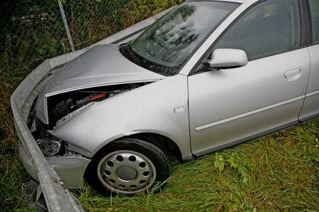 Front of new car after a car crash. Drunken driving? photo