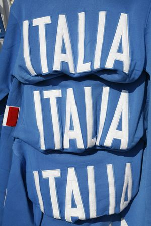 fanaticism: Italian national team soccer T-shirts for sale. Stock Photo