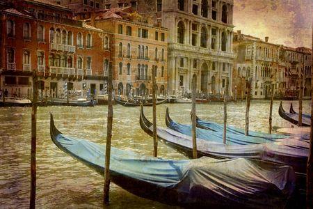 Postcard from Italy. - Parked gondolas Grand Canal - Venice. Stock Photo