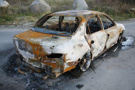 car theft: Burnt-out car after car theft.
