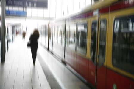 Stressed female taking the S-train - Berlin, Germany. Motion blur. photo