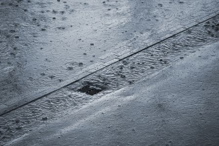 It is raining cats and dogs - very shallow DOF. Stock Photo