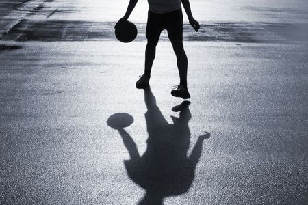 Street basketball just after the rain. Duotone.