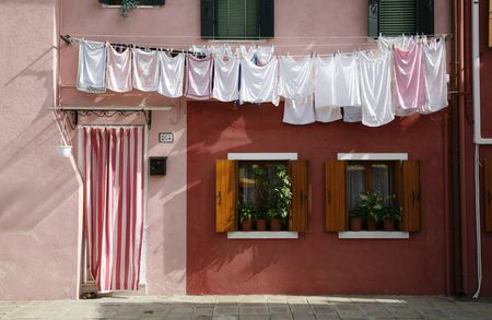 burano: Colorful house on the island of Burano in the Venetian lagoon - Italy.