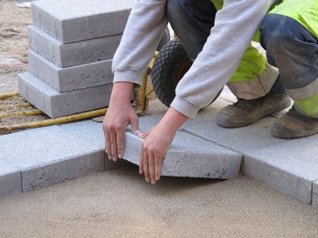 constructing: Paver on job. Constructing a difficult pattern.