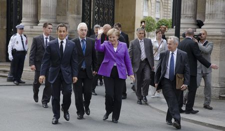 chancellor: PARIS, FRANCE - JUNE 11 - 2009: French president Nicolas Sarkozy and German chancellor Angela Merkel outside the Elysee Palace on their way to lunch. Editorial