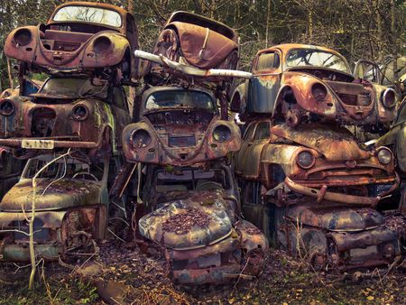 cross processed: Heap of old cars left in the nature near the Norwegian border - Sweden.  From the series scrap in the wood. Cross processed. Stock Photo