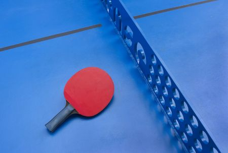 Detail of urban outdoor table tennis with red bat. photo