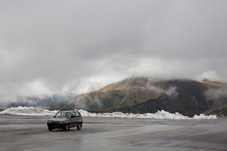 Lonely car in the parking lot - Pass of Pordoi, Italy just before the snow storm. Space for text. photo