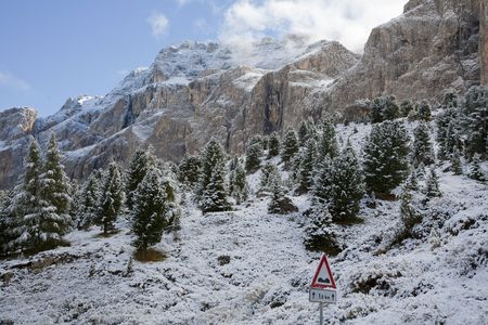 The Dolomites in the Veneto province of Northern Italy in late September. Seen from the mountain pass Sellai 2244 m above sea an early morning after snowfall. Stock Photo - 8196427