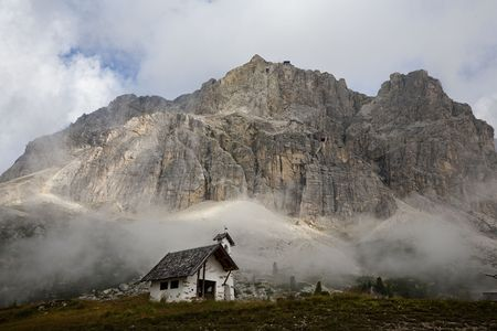 Early morning with low hanging clouds  in Passo di Falzarego - Dolemite, Italy.
