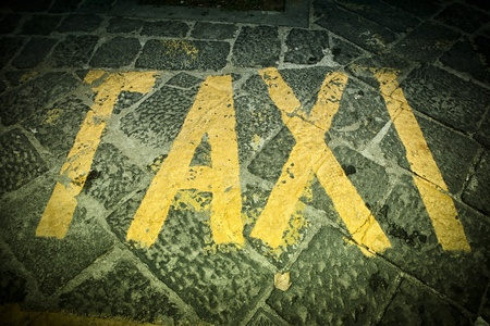 Taxi -  text painted in the street. Stock Photo - 17952004