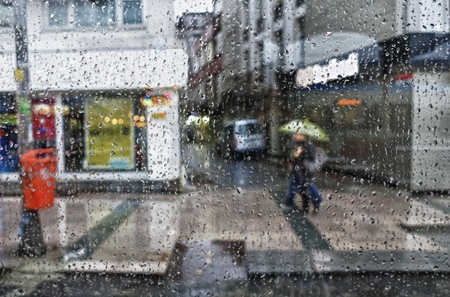 many windows: Street scene seen from a parked car during a rain shower. Stock Photo