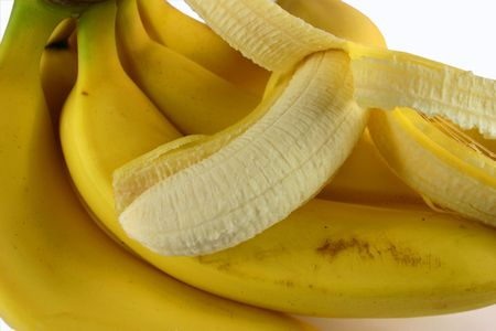 peeled banana: One peeled banana with bunch of bananas Stock Photo