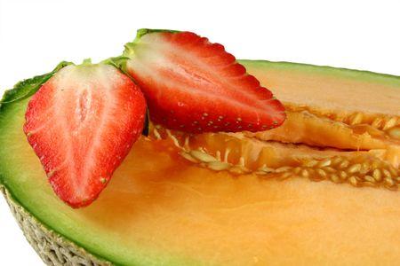 halved: halved strawberry on rockmelon