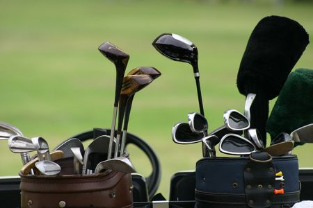 caddie: Close up of two sets of golf clubs Stock Photo