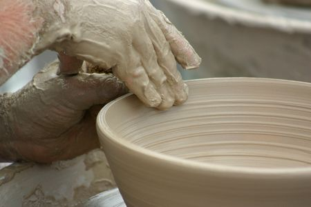 craftwork: Hands of potter shaping clay pottery bowl Stock Photo