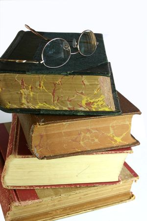 tatty: eye glasses on top of pile of old books Stock Photo