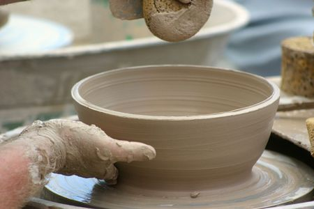 potters wheel: Pottery bowl being shaped on potters wheel