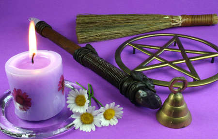 wicca: Candles, flowers, wand, bell, pentacle and besom