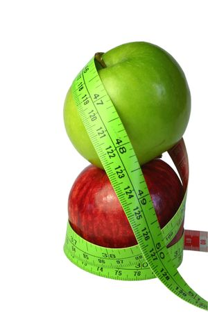 centimetre: Two apples stacked, with tape measure against white background