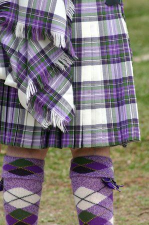 scot: Colorful scottish tartan kilt and matching argyle socks Stock Photo
