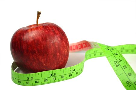 centimetre: Red apple with green tape measure on white background