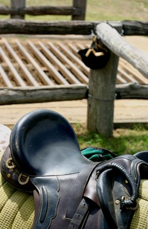 cattle grid: saddle on horse with cattle grid in background Stock Photo
