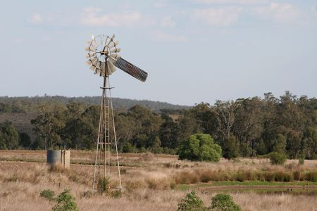 australia farm: rural water pump wind mill in drought area Stock Photo