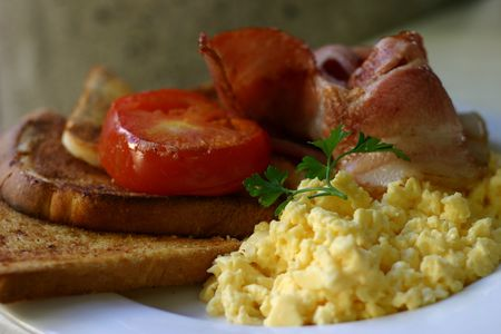 scrambled: Breakfast with bacon, scrambled eggs, tomato and toast