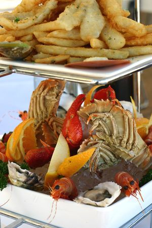 Hot and cold seafood - fried and fresh on platter at restaurant photo