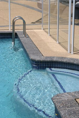 fence background: swimming pool details with clear safety fence